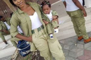 nysc3 300x200 - Female Youth corp member sows NYSC uniform for little daughter (photos)