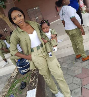 nysc3 - Female Youth corp member sows NYSC uniform for little daughter (photos)